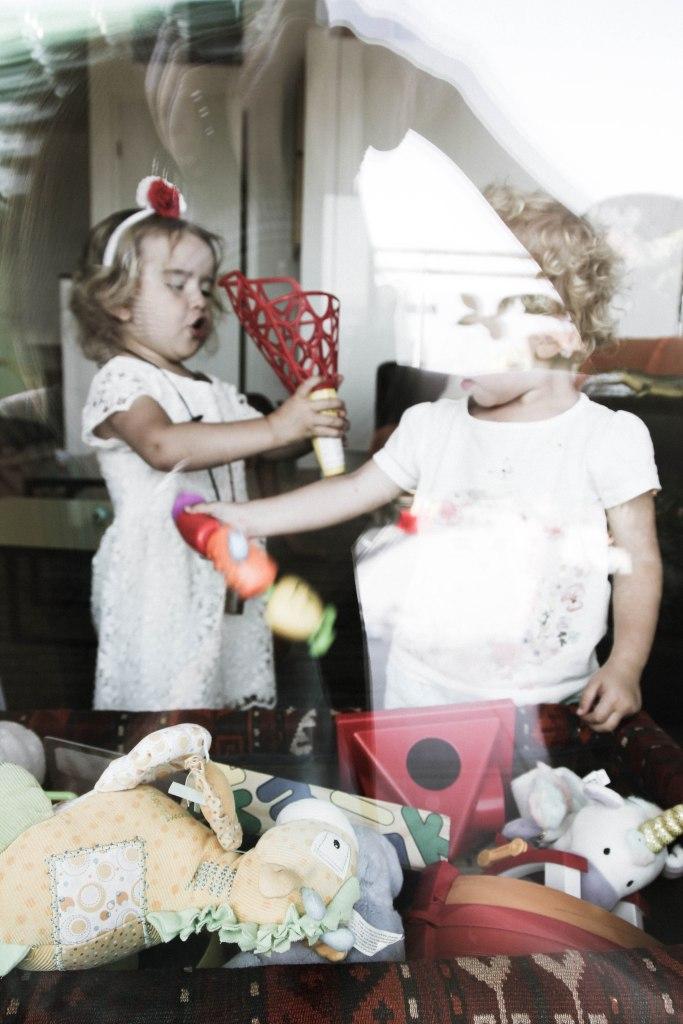 window shots of kids playing (3 of 1)
